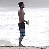 Justin Timberlake sported board shorts while hanging at the beach with Jessica Biel.