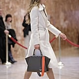 She's a Fan of Fendi's Strap You Collection, Affixing an Orange Design Onto Her Tote