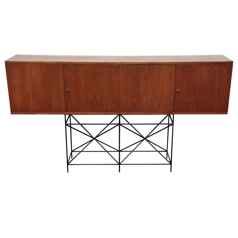 Perched on a gorgeous steel geometric frame, the Custom Made Architectural Cabinet on Stand (contact dealer for price) is made in Italy and thoroughly chic.