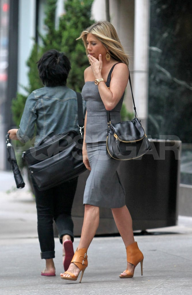 6a8c559557c36 Jennifer Aniston stepped out of an NYC hotel today wearing a Tom Ford  skirt