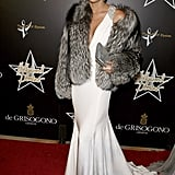 Channeling a vintage screen siren in fur and a creamy floor-length gown on the red carpet in 2008.