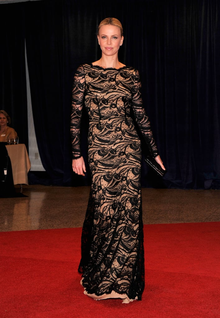 Charlize Theron wore a long lace gown.