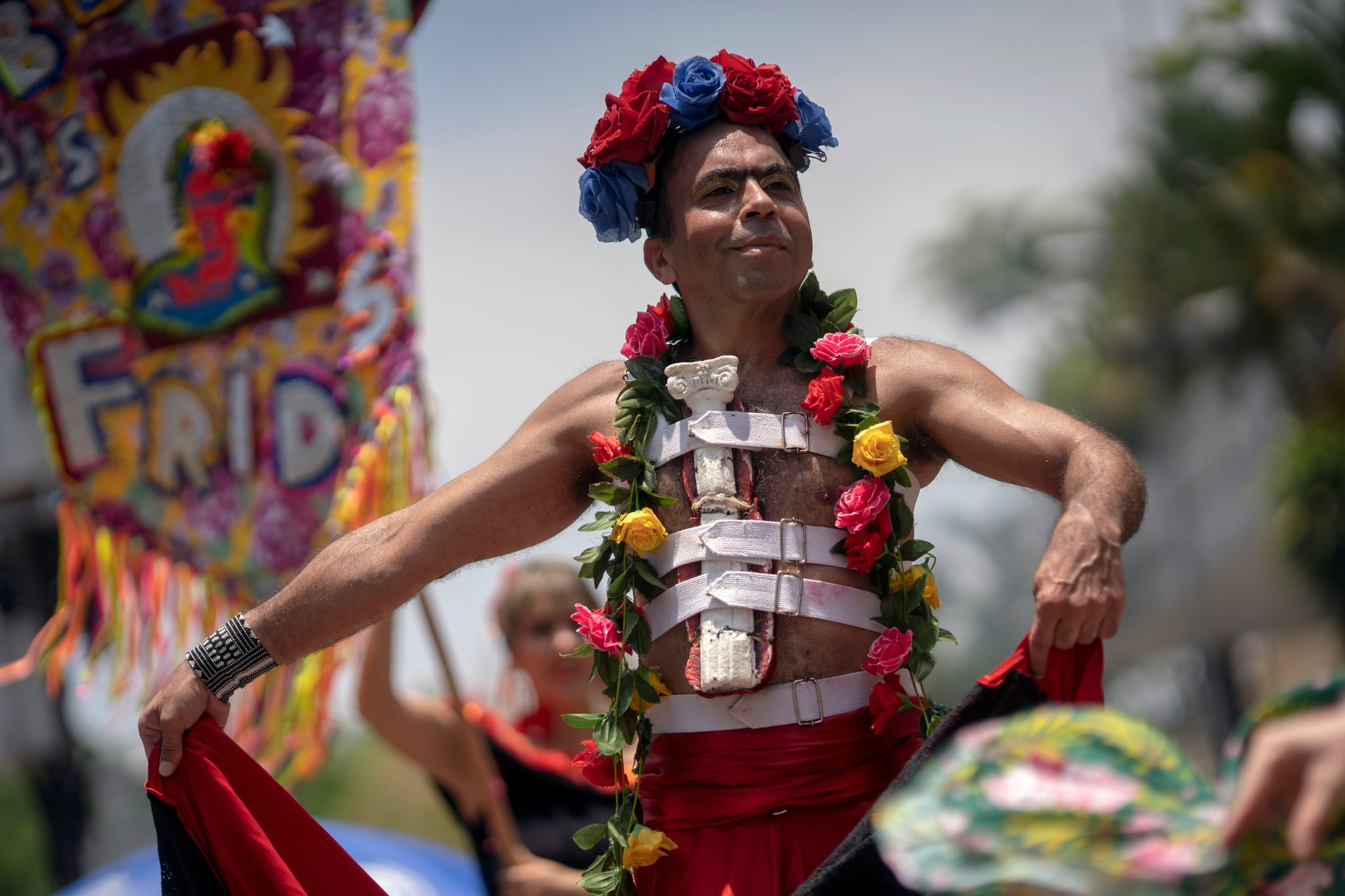 A reveller dressed as Mexican artist Frida Kalho takes part in the street carnival parade of the Bloco das Fridas at the XV Square in Rio de Janeiro, Brazil, on January 5, 2019, during the unofficial opening of the 2020 Carnival. (Photo by Mauro PIMENTEL / AFP) (Photo by MAURO PIMENTEL/AFP via Getty Images)