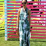 Jamie Chung paired her leaf-print Mara Hoffman maxi dress with a yellow fringe Uno De 50 bag, neutral sandals, a statement necklace, and oversize sunglasses.