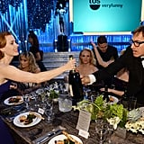 Amy Adams and her American Hustle director David O. Russell reached for the bottle at the same time.