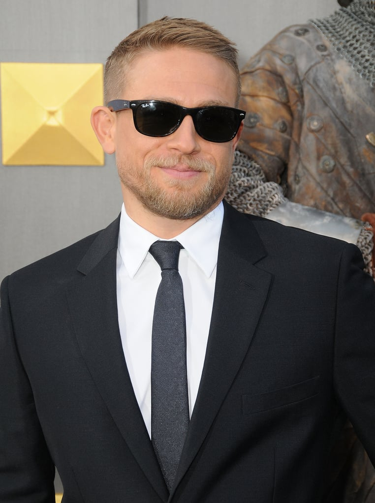 Charlie Hunnam looked so good at the King Arthur premiere on Monday night that we almost think the following pictures should come with a warning. The scorching Aries playing the lead in Guy Ritchie's latest film lived up to his fiery star sign by throwing on a pair of Ray-Bans on the red carpet and simply slaying us all. Read on, if you dare then relive that time he hooked up with Game of Thrones's Littlefinger (yeah, really). King Arthur hits cinemas 19 May.