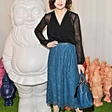 Elizabeth McGovern wore Mulberry's Nightie Skirt in Petrol Lace, Frill Blouse in Black and carried the Del Rey in Petrol from the Autumn Winter 2012 Collection.
