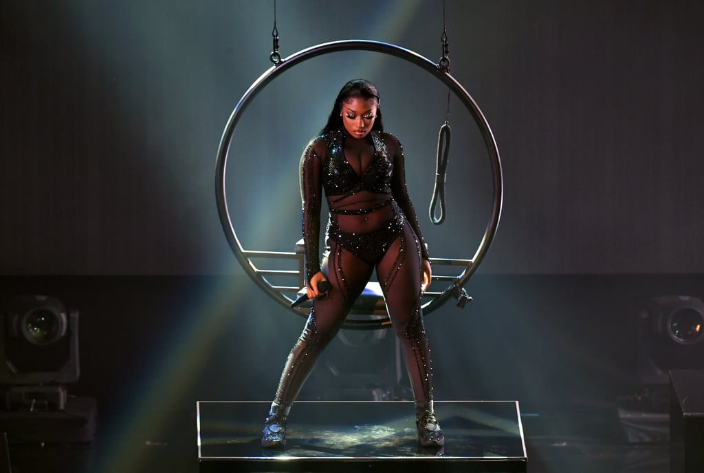 "If you've been listening to Megan Thee Stallion's debut album, Good News, since she dropped it on Nov. 20, you were more than ready for her performance at Sunday's American Music Awards. The ""Body"" rapper made her debut on the AMAs stage to perform her new single, and damn, did she raise the heart rates in the room! A short video played before the performance where Megan, sporting a sheer, bedazzled bodysuit, let viewers know that she loves her body, every inch, curve, and dimple. ""You may not think my body is perfect, and it probably never will be,"" the rapper narrated. ""But when I look in the mirror, I love what I see."" And THAT is what we love to hear! Of course, the sexiness didn't stop with the video. Clad in a shimmery black number, Megan reminded everyone that no one puts on a show like a Houston woman, and we're damn lucky for it. Several dancers and Megan put their large stage space to use, twerking, stepping, shaking, and doing all the other moves that none of our plebeian knees could attempt on a good day. In addition to her performance, Megan snagged five nominations, including best new artist and two nods for best collaboration for her songs with Cardi B and Beyoncé. I think it's fair to say this performance helped us all remember that, regardless of what she wins, this is Megan's world, and we're just living in it. Watch her performance ahead!      Related:                                                                                                           Presenting the Winners of the 2020 American Music Awards"