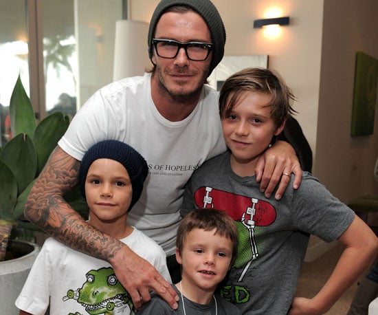 Slide Picture of David Beckham and Sons at Xbox 360 Party