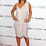 Alex Jones wore a gathered number with ankle-strap heels.