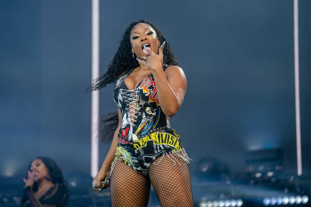 """Megan Thee Stallion took """"hot girl summer"""" to new heights with her 2021 Lollapalooza set on July 31. While playing at the Chicago-based festival, Megan shared a clip of her performance on Instagram. """"Over 180,000 HOTTIES!!! They said we had thee biggest crowd of @lollapalooza so far !!! Thank you Chicago,"""" the 24-year-old captioned the post. Artists like Juicy J, Marshmello, B. Simone, and more congratulated the rapper on her success with comments on her Instagram. """"If you love yourself, make some motherf*ckin' noise,"""" she yelled while onstage. """"That's what the f*ck hotties do: we spread positivity!"""" As part of her hour-long set, which was attended by Megan Fox and Machine Gun Kelly, she performed hits like """"Body,"""" """"WAP,"""" """"Hot Girl Summer,"""" """"Savage,"""" and """"Thot Sh*t."""" Ahead, you can become one of her """"hotties"""" while reliving some of the sexiest moments from her performance.      Related:                                                                                                           Marvel at Megan Thee Stallion's History-Making Sports Illustrated Cover"""