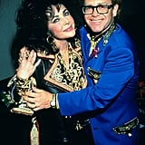 With good friend Elton John in 1992.