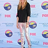 Cat Deeley edged up the red carpet in a black blouse and metallic silver trousers.