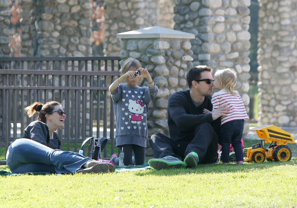Mark Wahlberg and Rhea Durham took their kids to a Beverly Hills park yesterday afternoon. They lounged on a blanket in the grass with Ella, Michael, Brendan, and Grace, and the couple even shared a sweet kiss while their little ones were off playing. It was the second fun outing for the family this week after they also visited Santa Claus at The Grove on Tuesday. Their festive photo op was just one of many adorable celebrity holiday moments this season including the Jolie-Pitts toy store stop and Justin Bieber's White House visit. Mark, Rhea, and their four kids are enjoying the Winter break before Mark gets back to work in the new year, when he'll be promoting Contraband ahead of its mid-January release.
