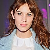 To get a fresh-faced look similar to Alexa Chung's, try a little BB cream, flicked liquid liner, and a pretty pink gloss.