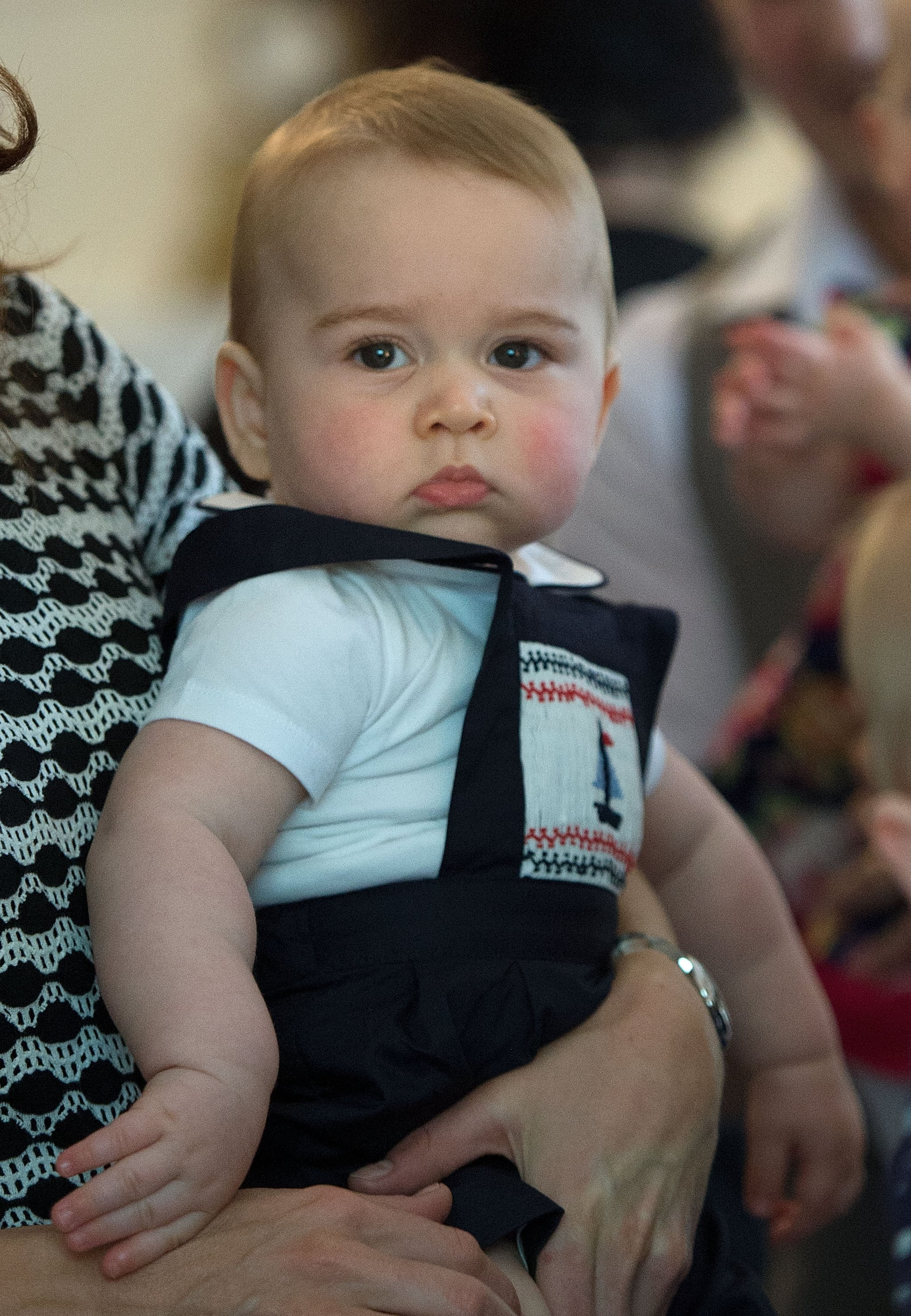 George's not-so-excited face at his first official royal event.