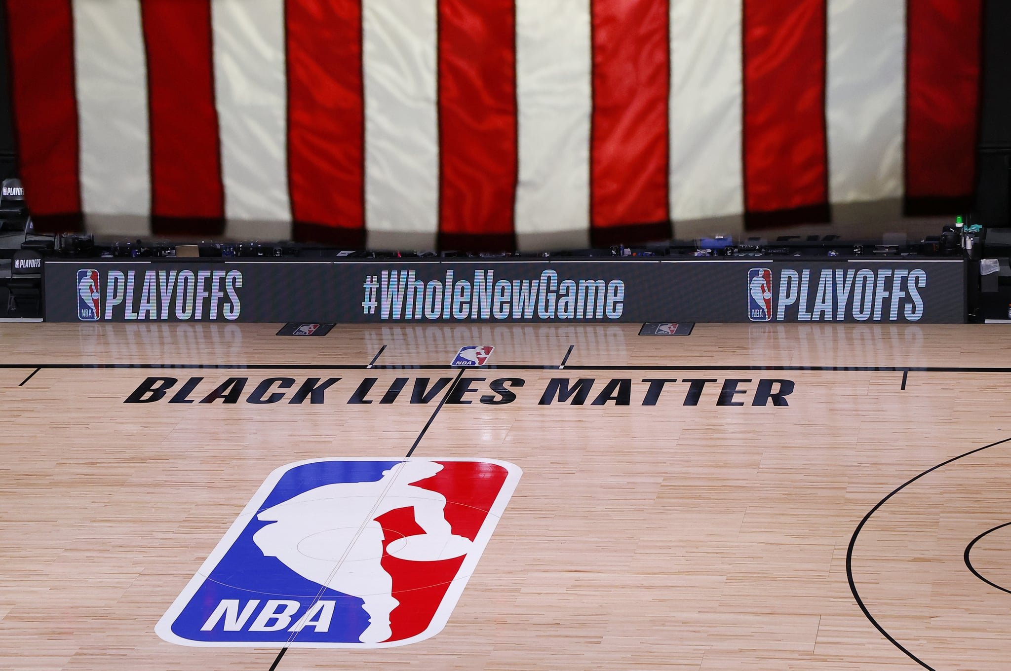 LAKE BUENA VISTA, FLORIDA - AUGUST 26: An empty court and bench is shown following the scheduled start time in Game Five of the Eastern Conference First Round between the Milwaukee Bucks and the Orlando Magic during the 2020 NBA Playoffs at AdventHealth Arena at ESPN Wide World Of Sports Complex on August 26, 2020 in Lake Buena Vista, Florida. The Milwaukee Buck have boycotted game 5 reportedly to protest the shooting of Jacob Blake in Kenosha, Wisconsin. NOTE TO USER: User expressly acknowledges and agrees that, by downloading and or using this photograph, User is consenting to the terms and conditions of the Getty Images Licence Agreement. (Photo by Kevin C. Cox/Getty Images)