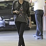 Charlize Theron wore red TOMs and a leather jacket to lunch.