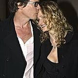 Kevin sweetly kissed Kyra on the head during an event in NYC in March 2003.