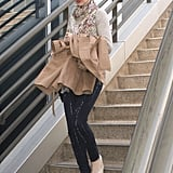 Anne Hathaway's casual travel style, including printed Paige Denim jeans, got a feminine jolt thanks to her floral scarf.