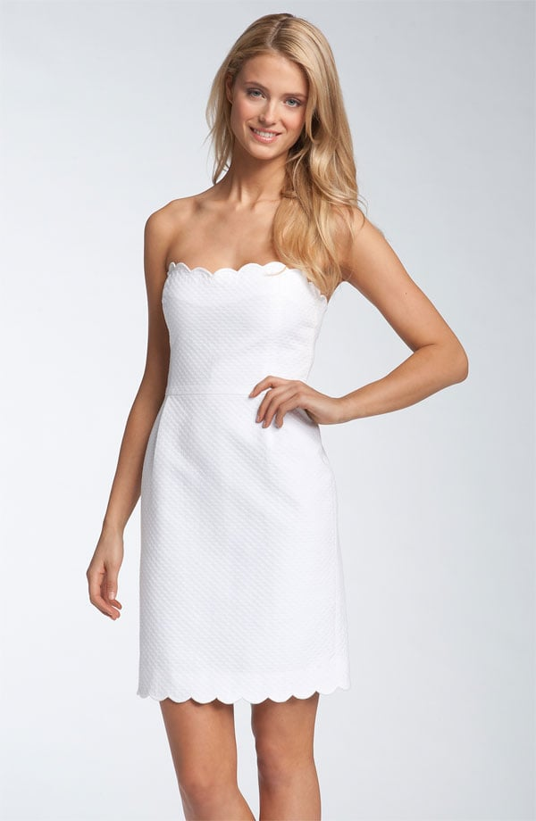 If you're hoping to keep your look simple, this strapless boasts a clean fit with just a dose of pretty scalloped detail at the hemline and bustline. It's a perfect look for a classic bride looking to unwind at the afterparty.  Kate Spade New York Teasdale Strapless Jacquard Dress ($358)