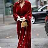 Invest in a long maxi dress that does all the work for you. If you do want to make your look feel festive, opting for velvet and accessorizing with gold jewelry will do the trick.
