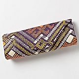 For something authentically ethnic, consider this handwoven clutch by artisans of Banago, which is crafted from colored wild grasses.  Anthropologie Mayumi Clutch ($48)