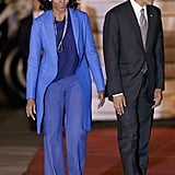 Michelle Obama stuck to various shades of blue in Pretoria, South Africa. To break up the monochrome look, she wore two Pearl Paradise necklaces.