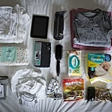 Joanna's bag included Pampers diapers, little white clothes, trousers, snacks and gummi candies, clothes, a towel, toiletries, an iPad tablet, a Camelbak water bottle, and maternity pads.