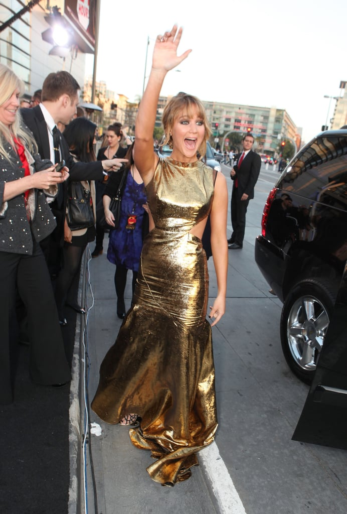 Jennifer Lawrence showed her excitement as she arrived at the LA premiere of Hunger Games.