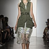 An army vest to toughen up a floral dress.