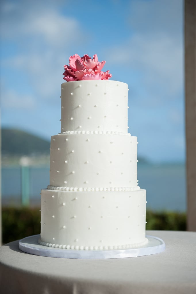 The details on this classic wedding cake are both soft and intricate at the same time — the delicate piping and smooth fondant look almost too sweet to eat.