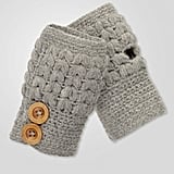 We love these preppy cable-knit textured fingerless gloves. Fred Flare Texting Gloves ($8)