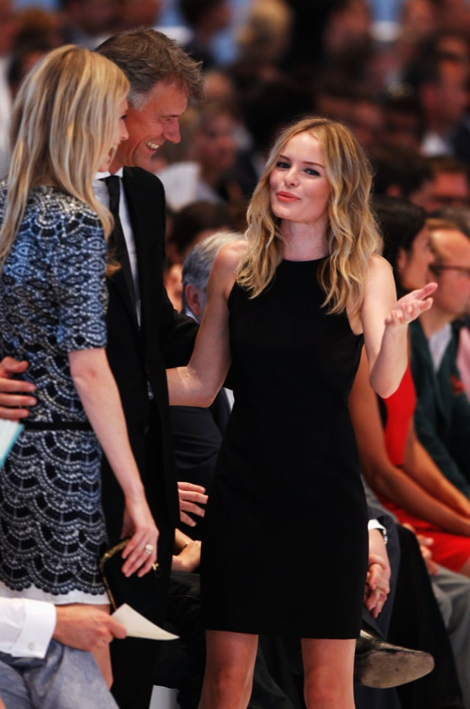 Kate Bosworth greeted Poppy Delevingne at the Hugo by Hugo Boss fashion show in Germany.