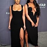 Kim Kardashian and Kourtney Kardashian at the amfAR New York Gala in 2019