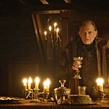 Walder holding a golden chalice while making a speech at the Red Wedding