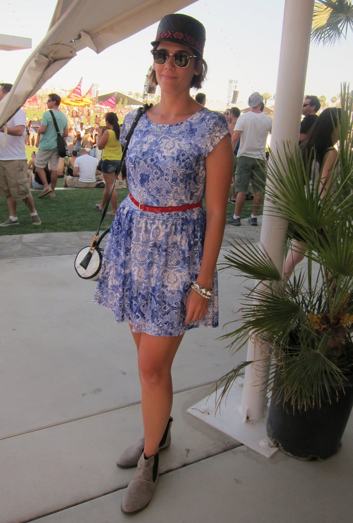 A sweet printed dress is accessorized with a bright red belt and feathered cap. Source: Chi Diem Chau