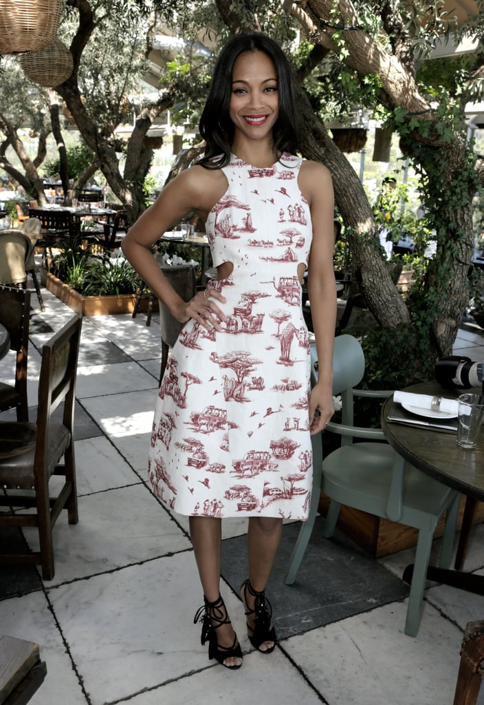 Zoe Saldana add a touch of sass to a ladylike silhouette in a printed Carven dress with strategic cutouts and black lace-up Jimmy Choo sandals The Hollywood Reporter luncheon in LA.