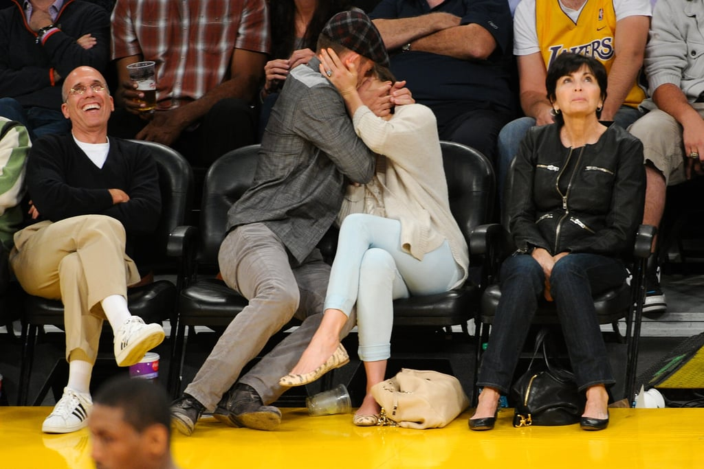 They embraced for the cameras while sitting front row at a May 2012 Lakers game.