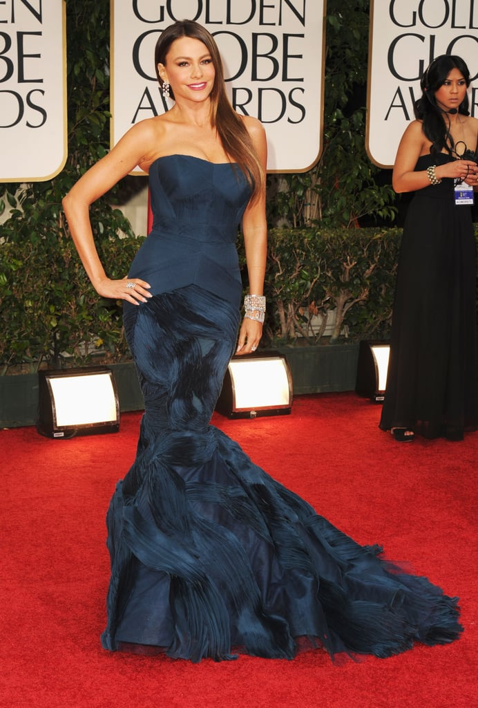 Sofia Vergara looked gorgeous in a deep-hued Vera Wang gown at tonight's Golden Globe Awards in LA. She brought her niece, who wore jewelry from Sofia's Kmart line, along for the show. Sofia's up for best supporting actress in Modern Family, and her costar Eric Stonestreet is also nominated this year. The whole cast has a chance to win though, since the comedy is a contender in the best TV comedy category. There is so much excitement on the red carpet, so be sure to vote on all of Bella and Fab's beauty and fashion polls!