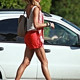 Stacy Keibler showed off her legs in brightly colored shorts.