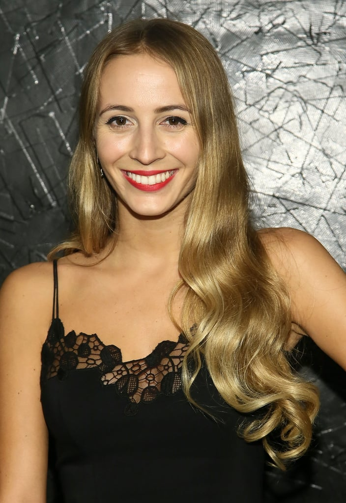 With her defined brows, brushed-out waves, and bright red lipstick, Harley Viera-Newton was right on trend.