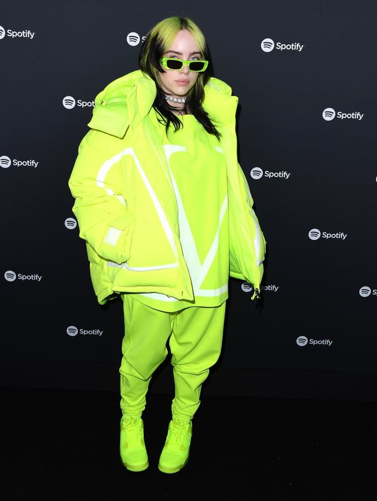 """Billie Eilish is living proof that you can never have enough neon in your wardrobe. The """"Listen Before I Go"""" singer attended the Spotify Best New Artist 2020 Party in Los Angeles on Thursday in a slime green (or possibly highlighter) Valentino puffer jacket, matching joggers, and an oversize T-shirt. Billie paired the look with Gucci sunglasses that were an equally dazzling shade of green and sneakers that blend right in with the rest of her outfit.  Billie also accessorized with a silver faux pearl necklace, a matching earring on one ear, and a silver cross earring on the other, making for an outfit that looks altogether brilliant and expensive. Keep scrolling to take a closer look at Billie's all-green look from all angles ahead.      Related:                                                                                                           Kylie Jenner's Disney Gucci Jeans Are Out of My Budget, but I'm Still Holding My Credit Card"""