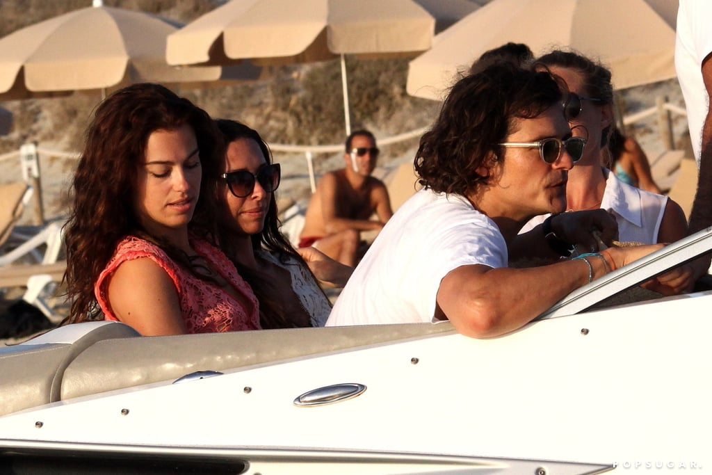 """All eyes were on Orlando Bloom when he hung out with Erica Packer, the estranged wife of Australian businessman James Packer, during a boat excursion in Formentera, Spain, last week. He later popped up at a restaurant, where he let loose when Pharrell's """"Happy"""" started playing. He stopped to take photos for a few fans, but didn't let the snaps keep him from getting right back into his moves.   Orlando and Erica's outing added to the tangled web of rumors surrounding the Packers and Orlando and his estranged wife, Miranda Kerr. After Miranda and Orlando announced their separation last year, there were reports that the former Victoria's Secret Angel was dating James. However, she brushed off the romance claims in July, saying, """"We've been friend for years. [Rumors] happen all the time with me, it happens to Orlando [too]. We understand it. As long as we both know [the truth], then it doesn't really matter what people think. People can speculate as much as they like.""""  Of course, his relationship with Erica is hardly the only drama surrounding Orlando at the moment. The actor made major headlines last week when he was caught on camera getting into a scuffle with Justin Bieber in Ibiza. To add to the confusion, Orlando was recently seen hanging out with Justin's ex Selena Gomez, although sources deny that anything romantic happened between the two of them."""