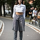 Sara Sampaio Rocked a Cropped Button Up and Tweed Trousers During MFW