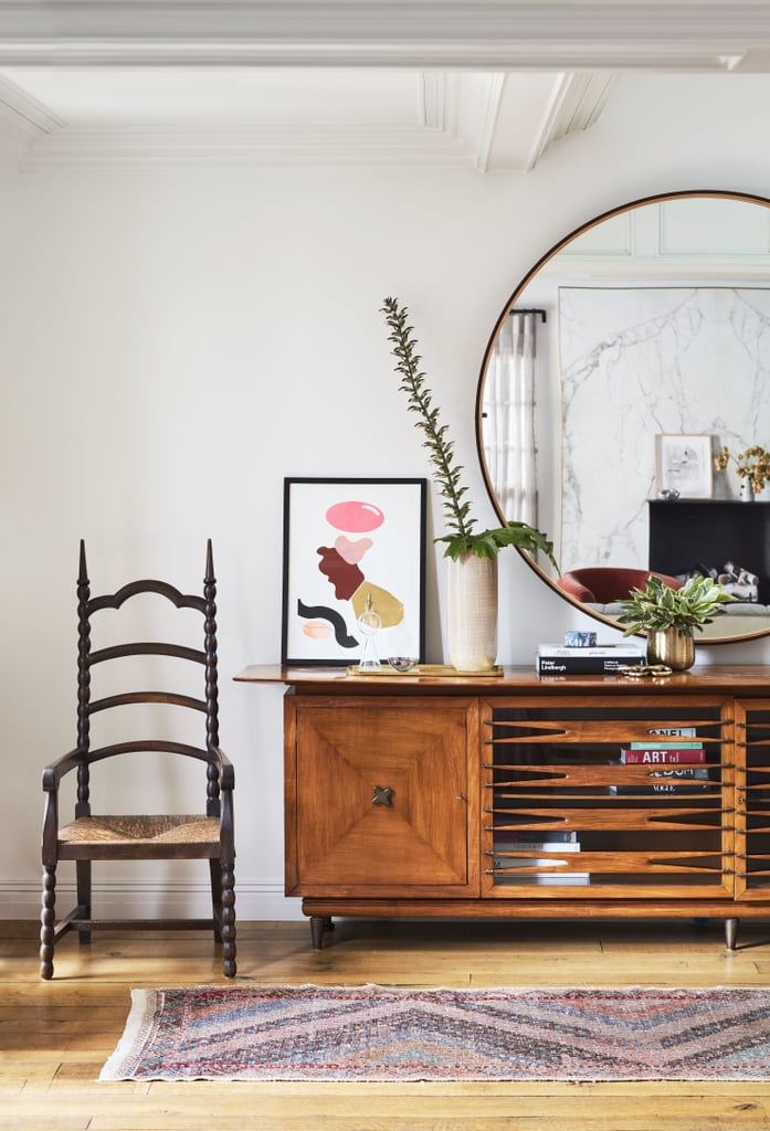 We love how the actress puts a modern spin on a space using super eclectic pieces, like this Gothic chair and a credenza that screams 1950s chic.