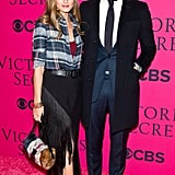 Spicing things up for the Victoria's Secret Fashion Show, Olivia looked playful in fringe and bold accessories while her mate had fun with a textured tie.