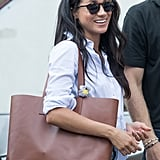 Meghan teamed her shirt with an Everlane bag.