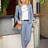 Mastering the art of the fashion-blogger pose, Suki showed off her love for trouser suits back in May 2012 at a London party.