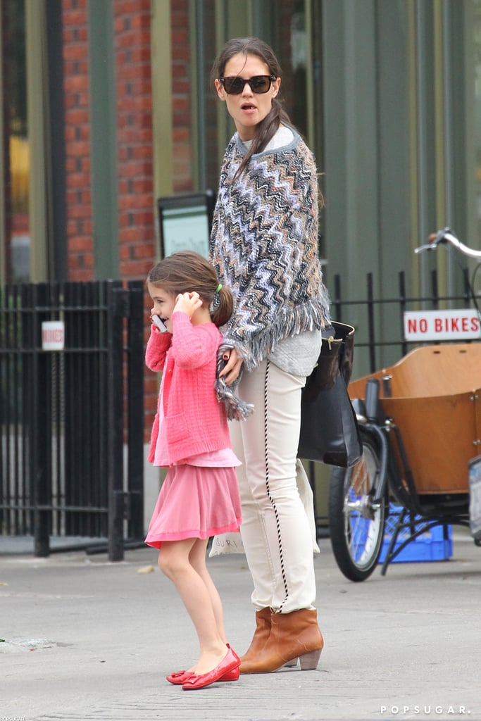 Katie Holmes reached for Suri Cruise's hand.